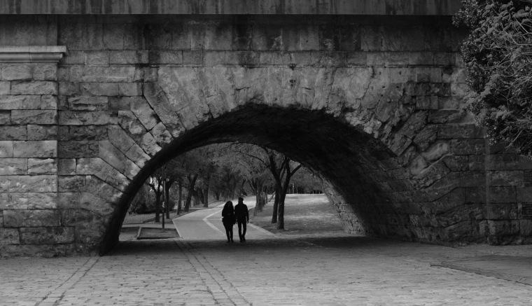 Walking under a bridge